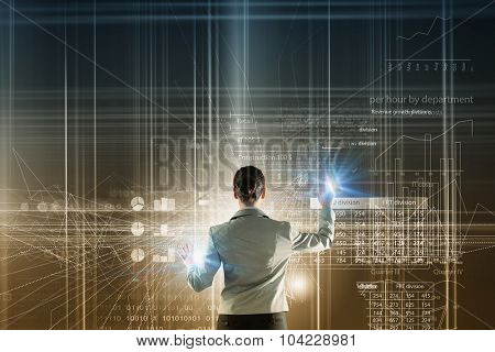 Back view of businesswoman working with digital virtual panel