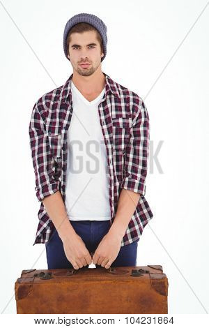 Portrait of confident man holding bag while standing against white background