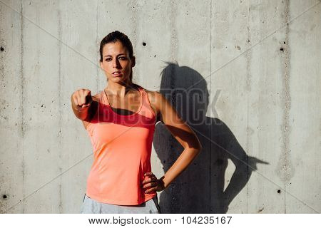 Confident Motivated Sportswoman Pointing