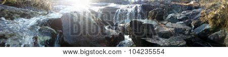 Cascade Of Water From The Mountains In The Arctic