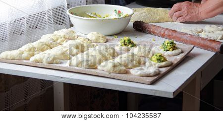 Preparation Of House Pies With Onions And Eggs