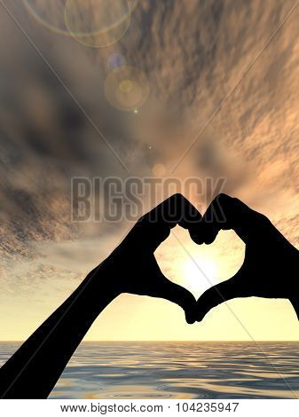 Concept or conceptual heart shape or symbol made of human or woman and man hand silhouette over a sky and sea or water at sunset background