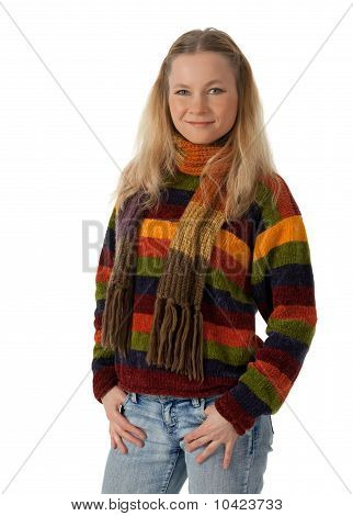 Young Woman Wearing A Sweater Holding Hands In Pockets