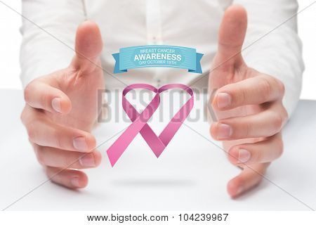 Hands holding against breast cancer awareness message
