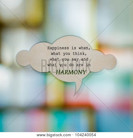 Meaningful Quote On Paper Cloud With Blurred Colorful Background