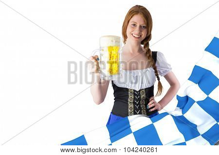 Oktoberfest girl smiling at camera holding beer against blue and white flag