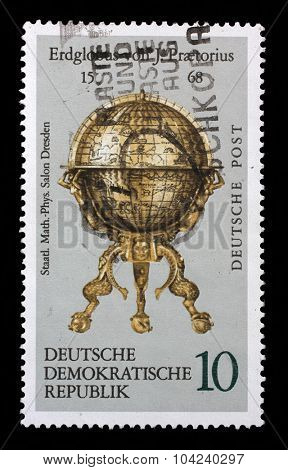 GDR-CIRCA 1972: A stamp printed in the DDR (East Germany) shows vintage globe, one stamp from series devoted State saloon of physics in Dresden, circa 1972