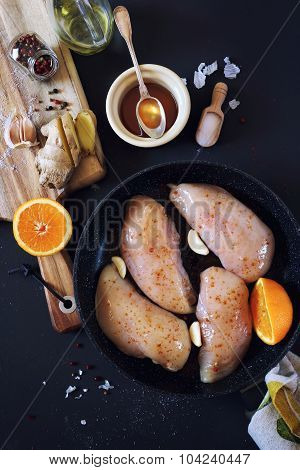 Cooking: ingredients for roast chicken with oranges and honey