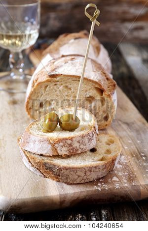 French Country Bread, Olives And Wineglass