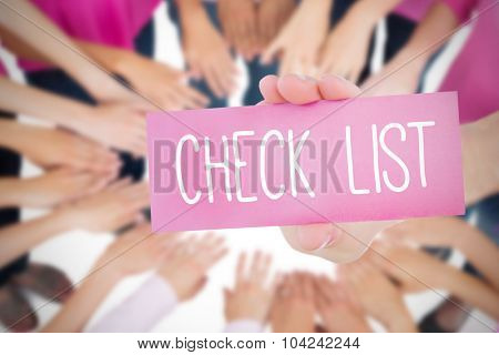 The word check list and young woman holding blank card against oktoberfest graphics