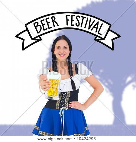 Pretty oktoberfest girl holding beer tankard against beer festival banner