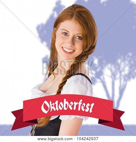 Oktoberfest girl smiling at camera against oktoberfest banner