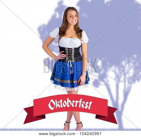 Oktoberfest girl smiling at camera against oktoberfest banner