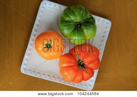 Colorful Heritage tomatoes on white plate