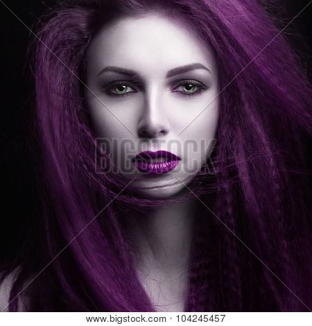 The girl with pale skin and purple hair in the form of a vampire. Insta color.