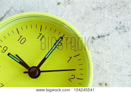 Green Clock Face Over A Dirty Background