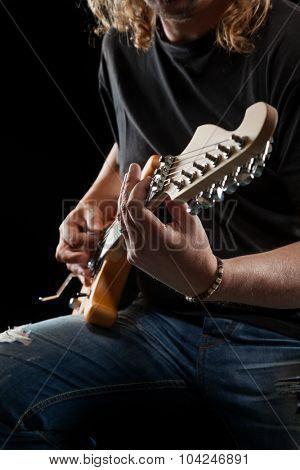 Hard rock heavy metal guitarist playing his instrument