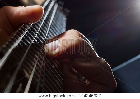 guitarist play on the electric guitar selective focus