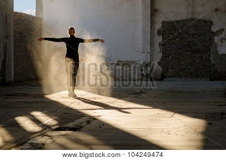 Young Modern Dancer Exercising And Dancing In Abandoned Building