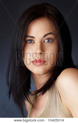 Woman With Dark Hair In Bob