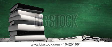 Desk against green chalkboard
