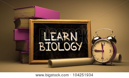 Learn Biology Handwritten by white Chalk on a Blackboard.