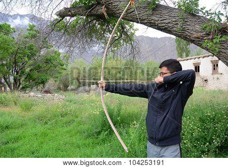 Archery Man Shooting Arrow With Bow