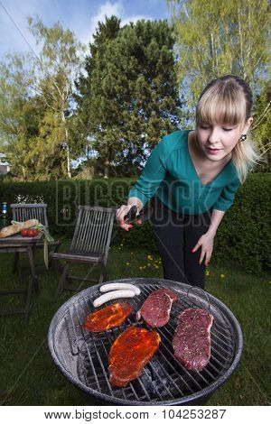 woman and a barbecue