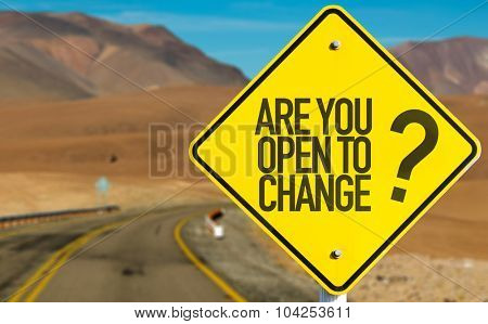 Are You Open to Change? sign with desert road on background
