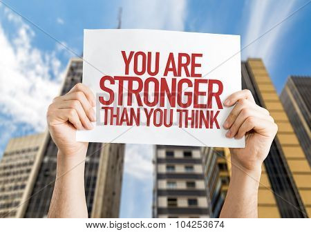 You Are Stronger Than You Think placard with urban background