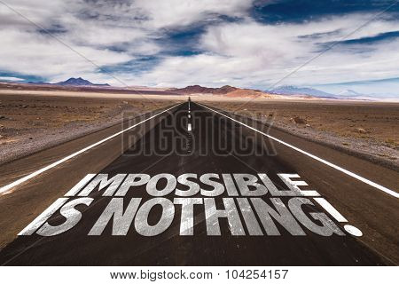 Impossible is Nothing written on desert road