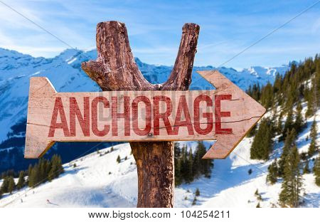 Anchorage wooden sign with winter background