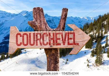 Courchevel wooden sign with winter background