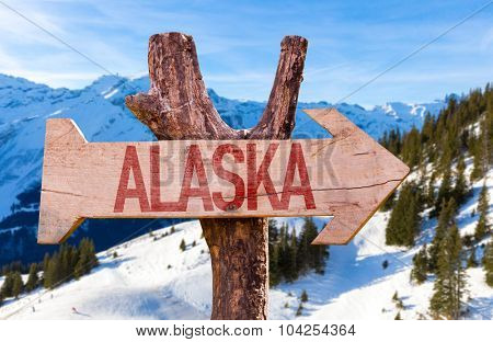 Alaska wooden sign with winter background
