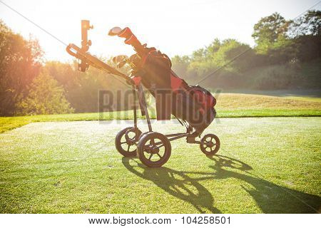 Close-up of golf trolley.