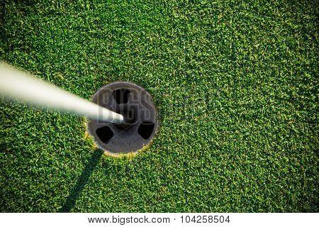 Close-up of golf hole.