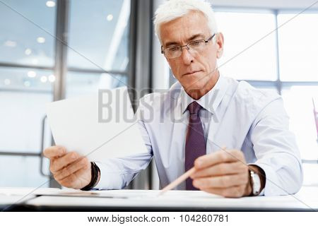 Businessman in office working with papers