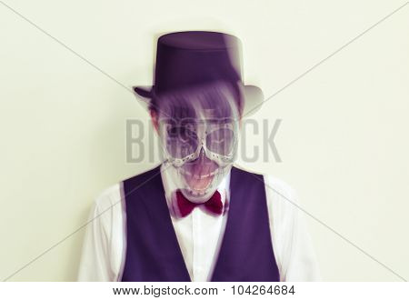 portrait of a man with calaveras makeup, wearing bow tie and top hat, in motion