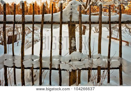The old fence in the snow
