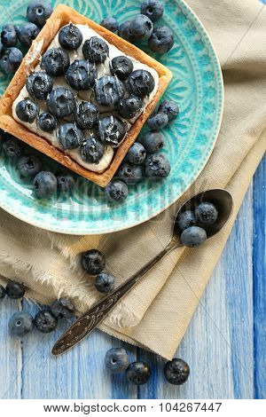 Still life with gourmet fresh blueberry tart