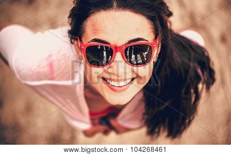 Portrait Of Young Girl Outdoor Looking Up