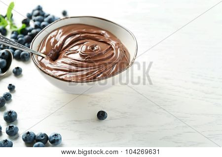 Beautiful composition with chocolate cream and blueberries