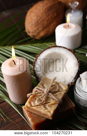 Spa coconut products on dark wooden background