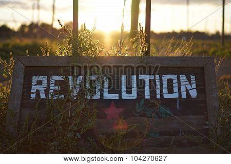 Revolution Sign in Sunset
