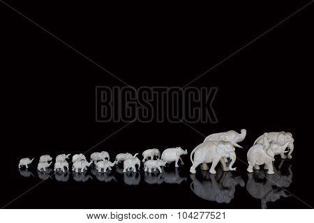 Carved ivory miniature elephants lined up