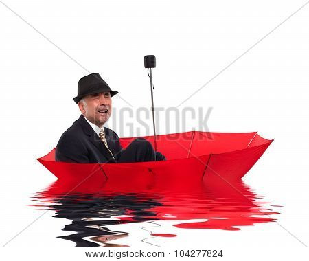 Businessman crying while floating on unbrella