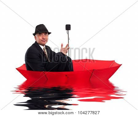 Business man floating on umbrella