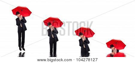 Business man flying with umbrella