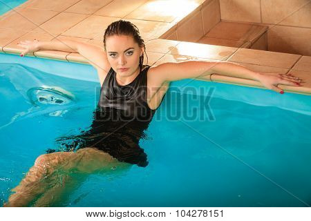 Sexy Seductive Woman Relaxing In Water At Poolside