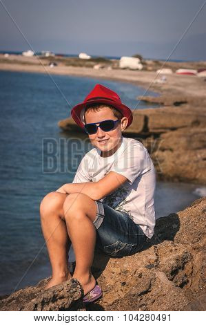 The Boy In A Red Hat